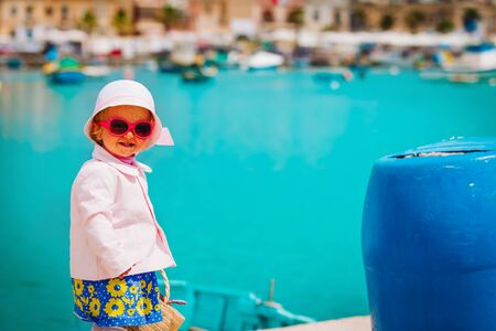 cute little baby girl travelling in Malta, Europe