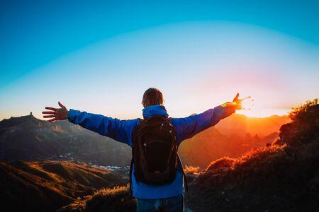 happy tourist enjoy hiking in sunset mountains 版權商用圖片