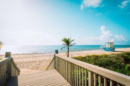 entrance to tropical beach with lifeguard cabin, Florida, USA