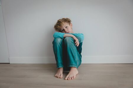 boy feeling anxiety and stress, kid staying home