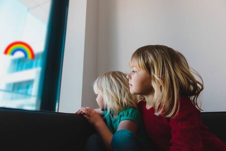 kids looking at the window while staying home, family on qurantine