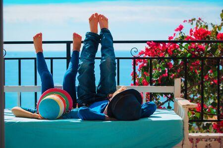 kids -little boy and girl- relax on balcony terrace
