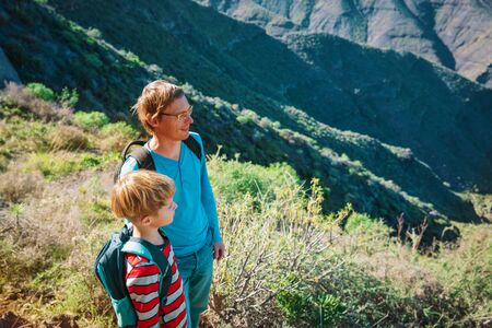 father and son travel in nature, family enjoy hiking in mountains