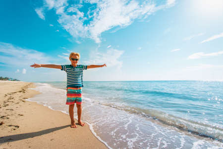 happy young boy on tropical beach vacation