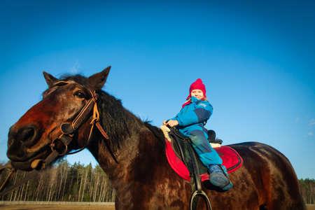 happy cute girl on horse ride in nature Foto de archivo
