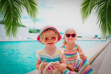 kids relax on tropical beach resort, family vacation Foto de archivo