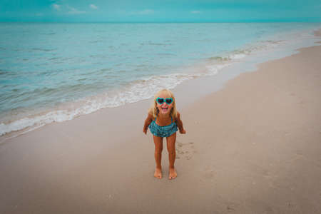 happy cute little girl on beach vacation