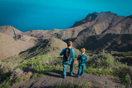 father and son travel in nature, family hiking Foto de archivo