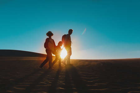 father with kids hiking at sunset, family travel in nature Foto de archivo