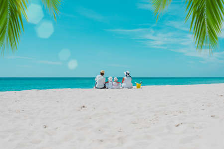 happy family with two kids on tropical beach vacation
