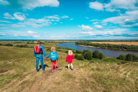 kids travel in nature, boy and girls enjoy scenic view