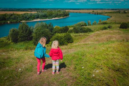 kids travel in nature, little girls enjoy scenic view