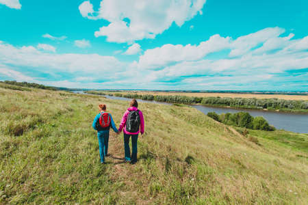 mother and son travel in nature, family hiking