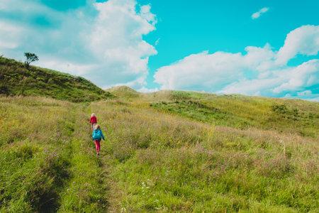 kids hiking in nature, little girls enjoy scenic view, active lifestyle Foto de archivo