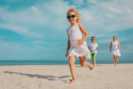 happy family play on tropical beach vacation