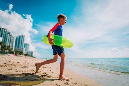 happy kid go swim on Miami beach vacation