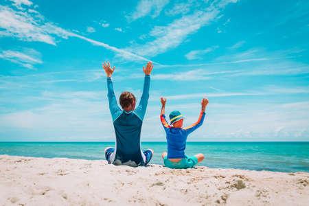 father and son having fun on tropical beach Foto de archivo