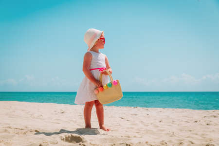 happy cute girl with big bag on beach vacation