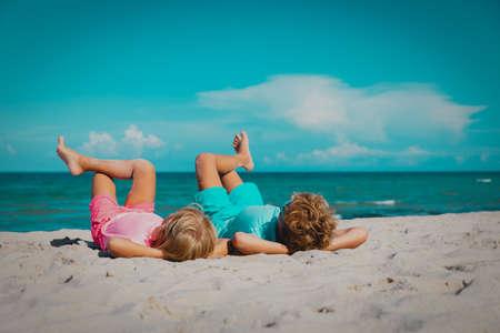 happy boy nd girl relax on tropical beach