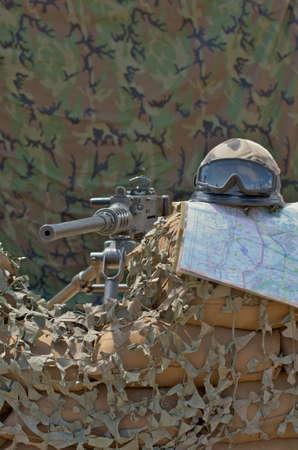 machine gun, helmet and map photo