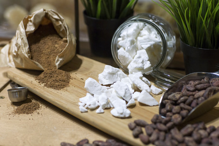 seed pots: Still life of sugar, coffee beans and cocoa. Spilled sugar, coffee beans and cocoa. Stock Photo