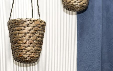 hinged: Planters for flowers. Hinged wicker flower vase. Stock Photo