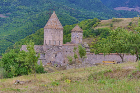 old tree: Armenian Apostolic Church. Mountain landscape, the monastery. The landscape in Armenia Tatev.