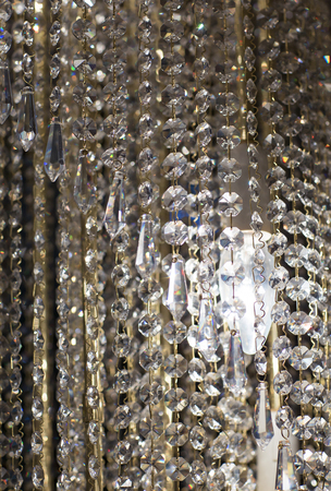 pendants: Brass chandelier with crystal. Lighted chandelier with crystal pendants.
