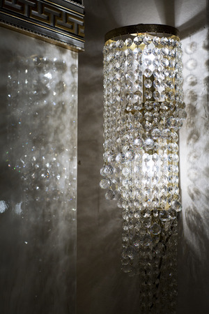 Brass sconces with crystal. Lighted sconces with crystal pendants.