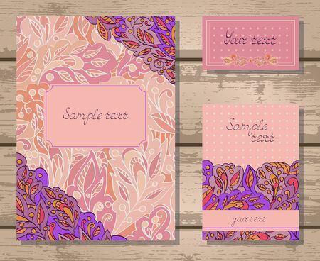 retro fashion: Vector set of templates invitations or greeting cards with decorative floral elements on a wooden background. Collection of templates in purple and pink colors.