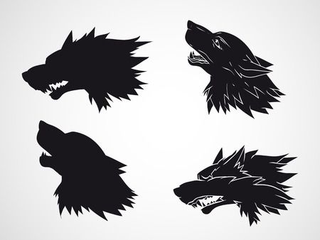 Vector set of hand drawn wolf heads. Black silhouette and stencil. Illustration