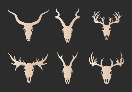 Vector set of six hand drawn gold silhouettes skulls of horned animals: stag, roe deer, moose and antelope on black background. For you design, print, tattoo or magic craft.