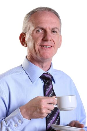 Experienced businessman having a break with a cup of coffee
