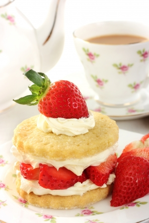 shortcake: Strawberry and cream shortcake and a cup of tea