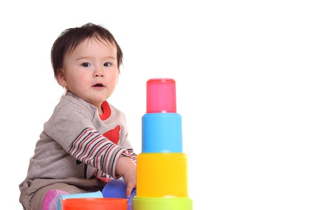 Toddler playing with brightly colored toy
