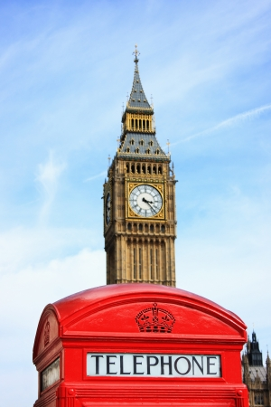 London red phone box with Big Ben in background  Focus on phone box Editorial