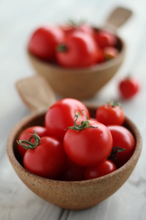 Two bowls of tomatoes with very small depth of field