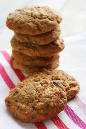 A stack of Homemade chocolate and nut cookies