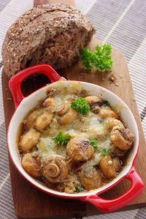 Baked garlic mushrooms covered in melted cheese