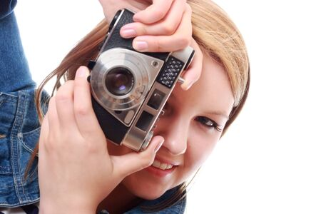 Pretty young woman taking photo with vintage camera