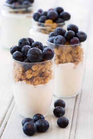 Healthy nutritious breakfast with yogurt, cereal and fresh blueberries