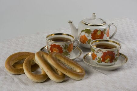 teaset: Tea-set with two cups and bakery.  Stock Photo