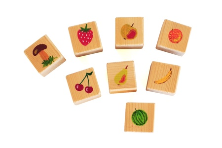 costruction: Wooden handmade colored cubes with fruits for early learning children Stock Photo