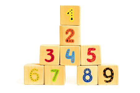 Tower of wood cubes with colored numbers photo