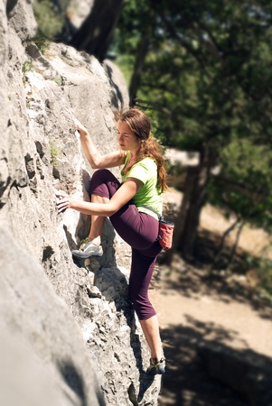woman climber on the rock photo