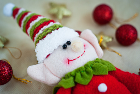 cute Christmas elf surrounded by Christmas toys photo