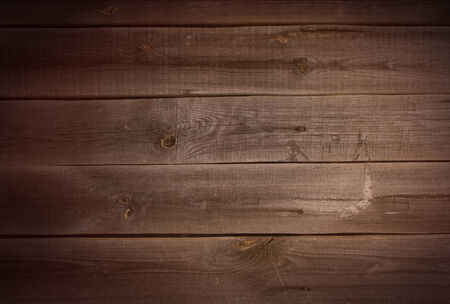 Background - old wood surface in dark colors photo