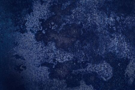 smearing: Abstract dark blue surface with light streaks