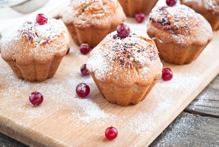 farinaceous: Cupcakes with black currant jam and some berries around