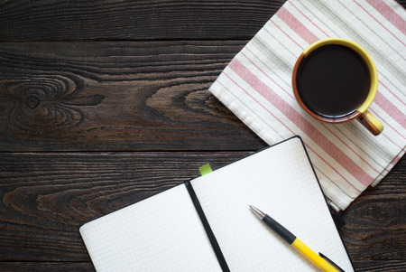 Notebook, pen and coffee pot on the table. Top view. Background for writing prescriptions photo